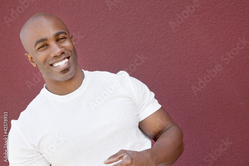 Portrait of a young muscular man over colored background