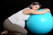 Pregnant woman and gym ball