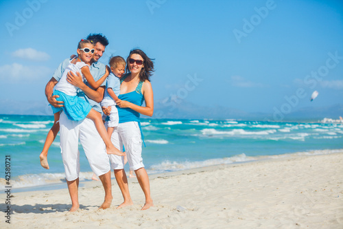 Family having fun on tropical beach