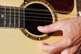 man hand play an acoustic twelve strings guitar poster