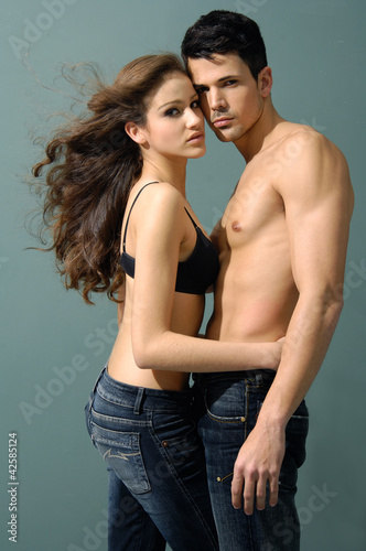 Sexy couple model against gray