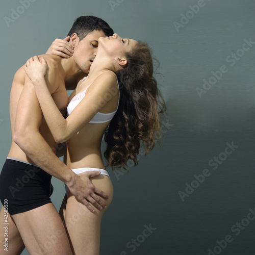 Sexy couple model against in the studio