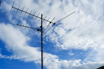 Home advance TV antenna on blue sky