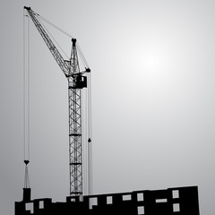 Silhouette of one cranes working on the building