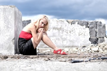 blonde girl sitting on roof