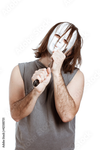 Scary bizarre masked man with knife
