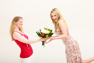 Vivacious woman receiving floral gift