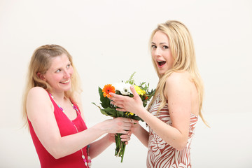 Woman exclaiming over a gift of flowers