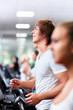 Smiling people on treadmills