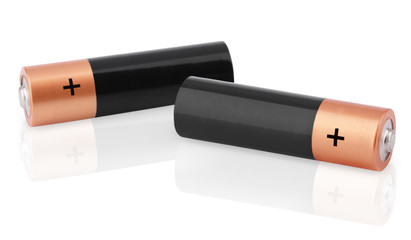 Closeup of two AA batteries on white