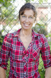 happy smiling mature woman in red checked shirt