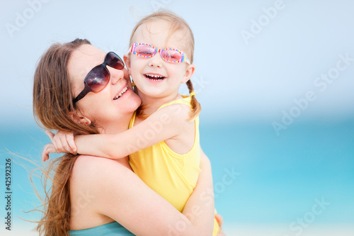 Family on summer beach vacation