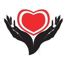 The silhouette of heart in female hands.