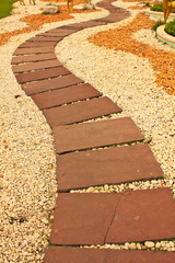 Stock Photo - red stone paved roads in the park
