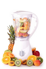 blender with assortment of fruits