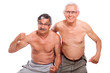 Happy naked seniors showing body