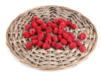 Raspberries on wicker mat isolated on white