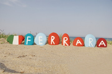 Ferrara, Italy, on colourful stones with heart flag