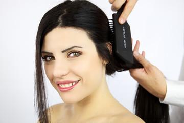 Wonderful female model getting hair brushed