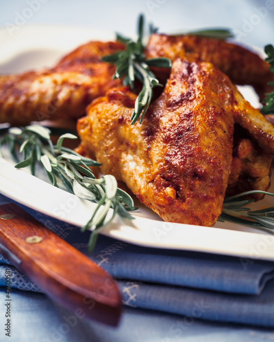Chicken wings with rosemary sprigs