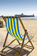 Single deck chair on the beach
