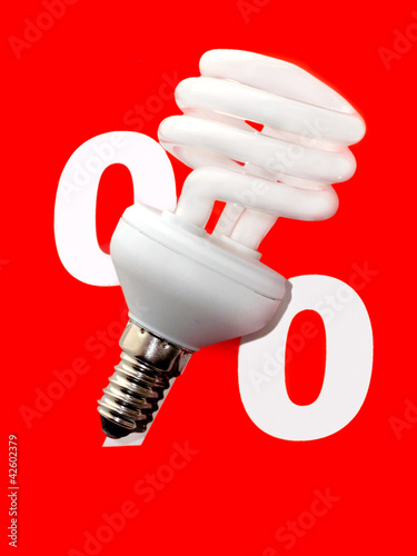 Energy saving light bulb on a red background