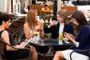 Group of friends enjoying cocktails