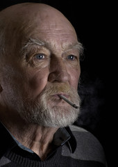 Ill old man smoking