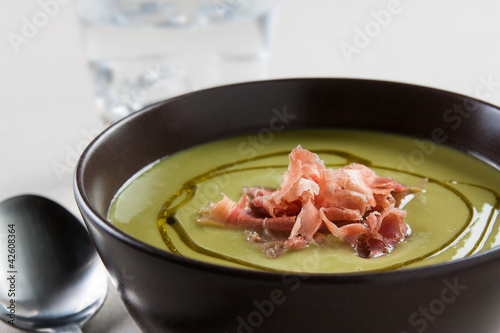 bowl of vegetable soup with ham