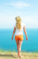 girl in orange shorts