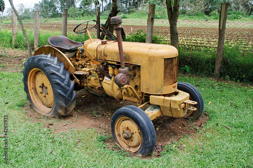 Yellow farm tractor