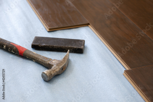 Hammer and Block with New Laminate Flooring