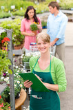 Smiling florist woman at garden centre inventory
