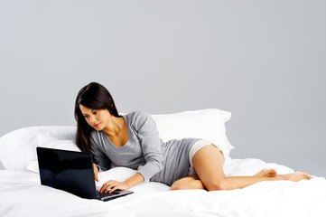 casual laptop bedroom woman