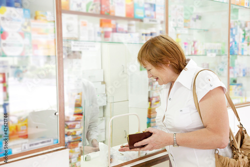 Mature woman buys drugs