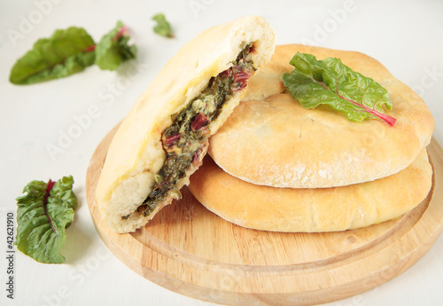 Pies with cheese, beet tops and chard