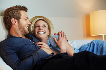 relaxing happy couple in a hotel room