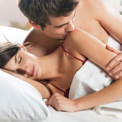 Couple making love in bed