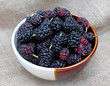 Black mulberries in a bowl