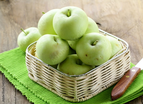 green ripe organic apples in the basket