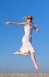 Barefoot girl running on open air