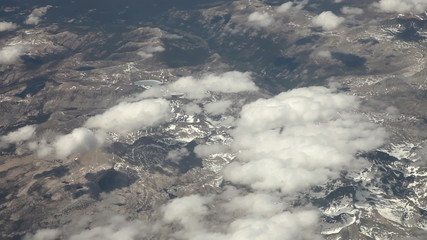 Flying  above snowy mountains in summer