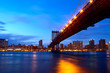 Manhattan Bridge with skyline after sunset, New York
