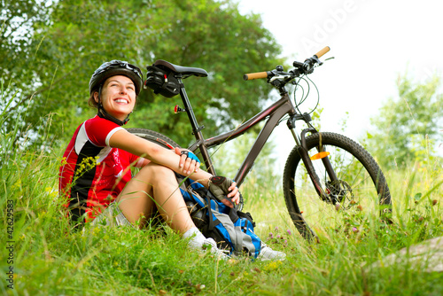 Fotobehang Wielersport Happy Young Woman riding bicycle outside. Healthy Lifestyle