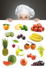 Female chef looking over fruit billboard