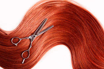 straight healthy woman hair and scissors