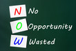 Acronym of NOW - No Opportunity Wasted on a chalkboard