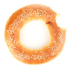 Bitten bagel with sesame seeds isolated on white
