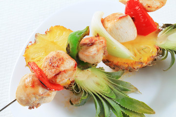 Chicken skewer and fresh pineapple
