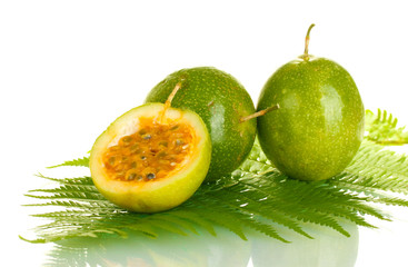 green passion fruit on white background close-up
